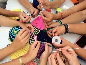 Group of people knitting together