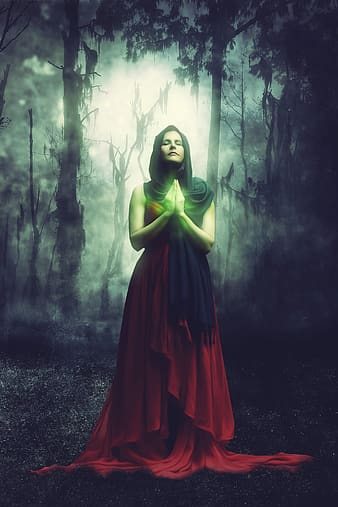 Photo of woman in red dress praying