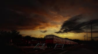 Timelapse photo of train and silhouette trees