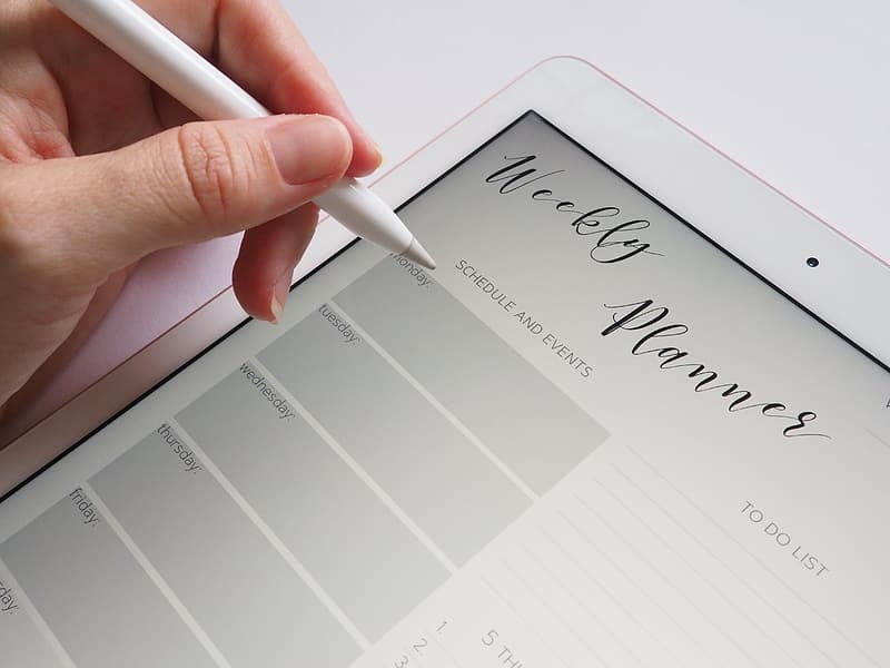 Person holding stylus pen white tablet computer