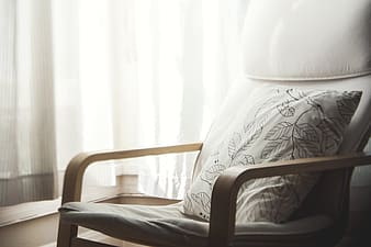 Silhouette photography of armchair and throw pillow indoors