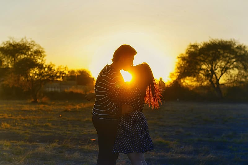Couple kissing during golden hour