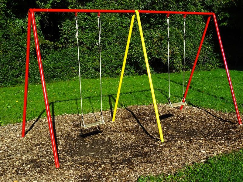 Red and yellow swing on playground