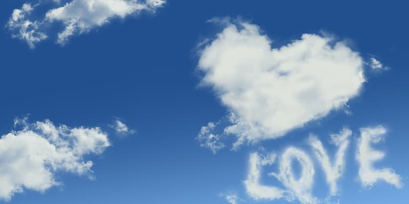 White clouds forming heart and love photo