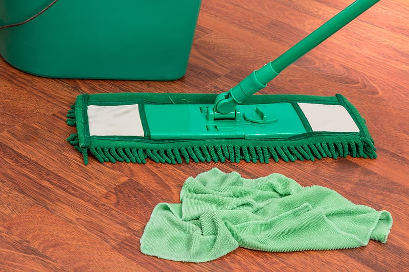 Green mop, pail, and towel