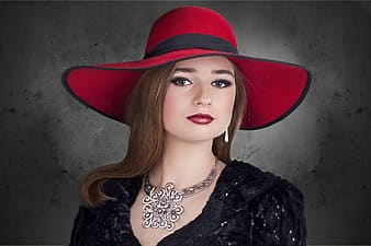 Woman wearing black dress and red hat