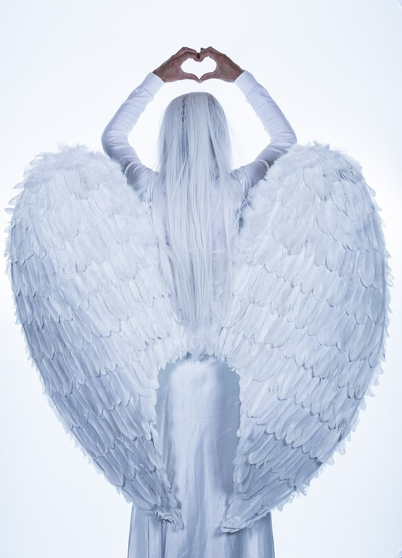 Woman in white angel wing