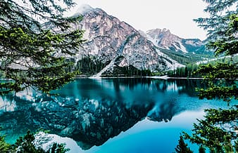 Mountain alps near body of water graphic wallpaper