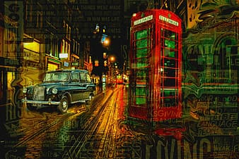 Classic blue car beside red telephone booth