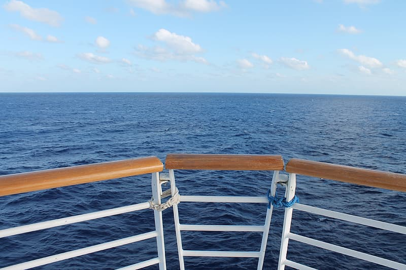 Close-up photography of brown and white boat handrails