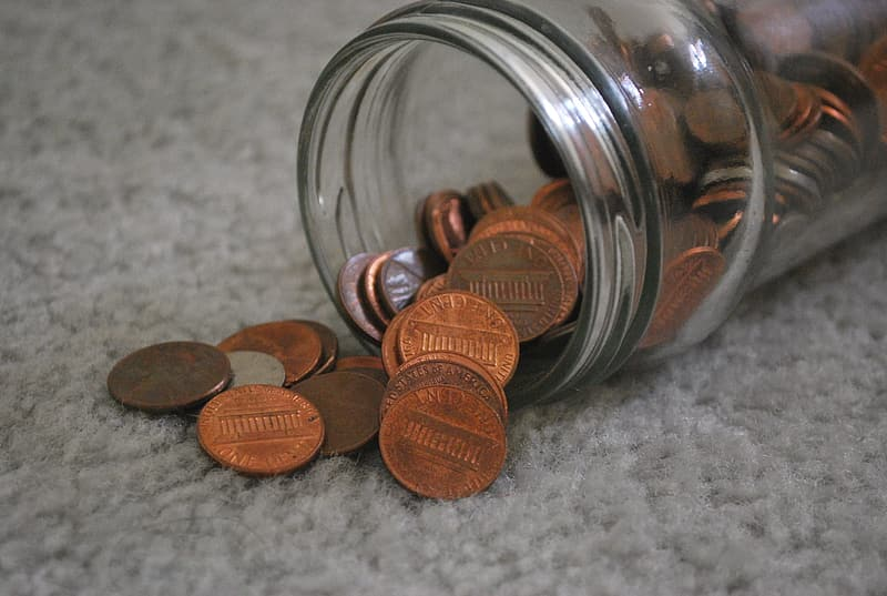 Bronze coins in clear glass jar