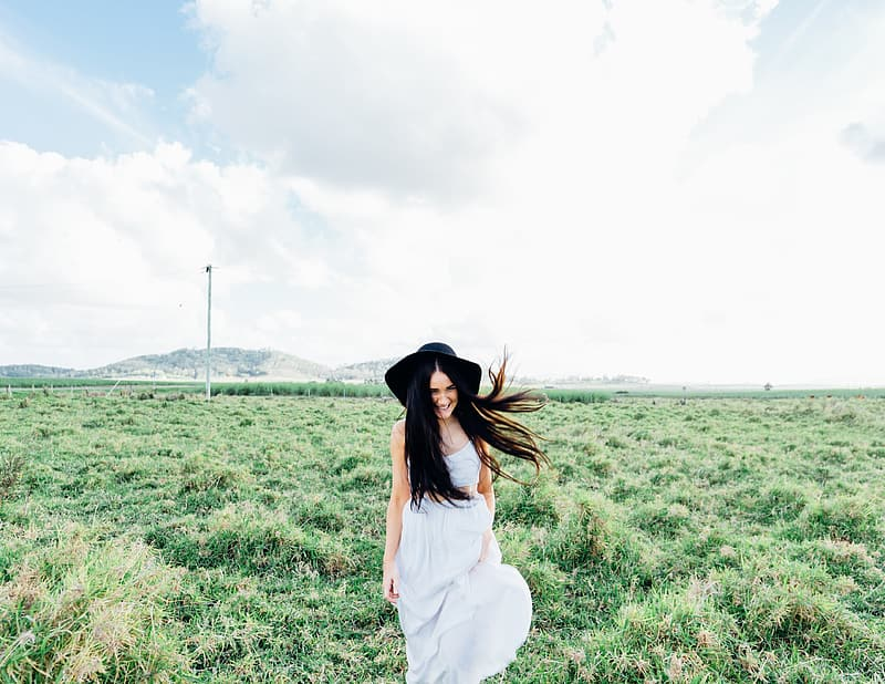 Black haired woman in white dress during day time