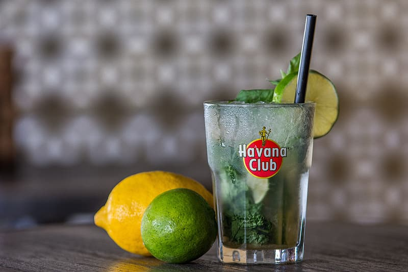 Havana Club drinking glass with lemon and lime on table
