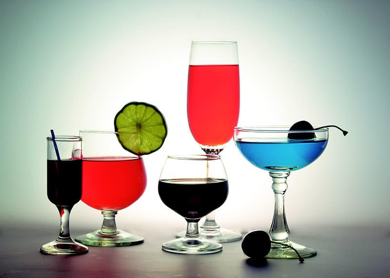 Six assorted filled wine glasses