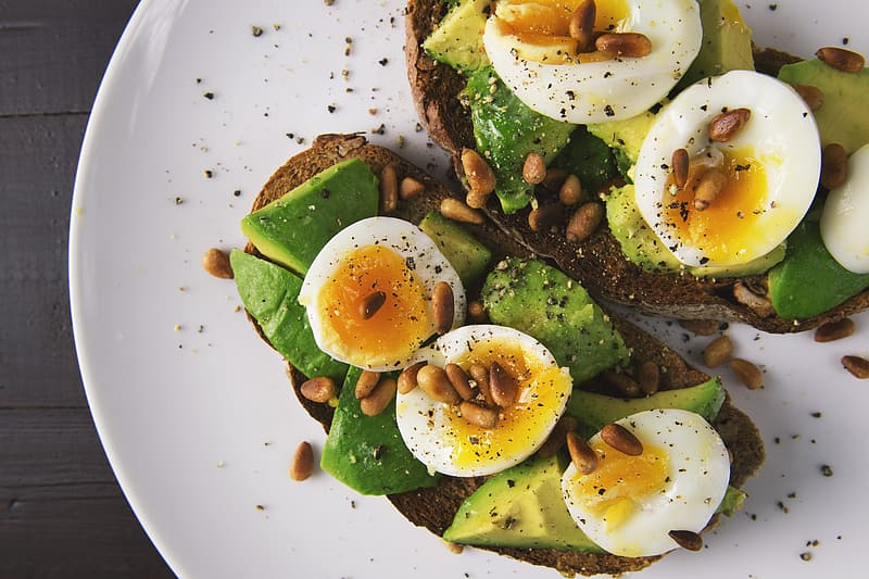 Boiled eggs with avocado slices and nut