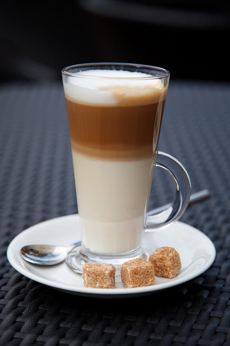 Brown liquid in cup with sugar blocks