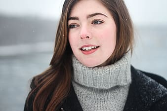 Woman in grey turtleneck sweater in snow