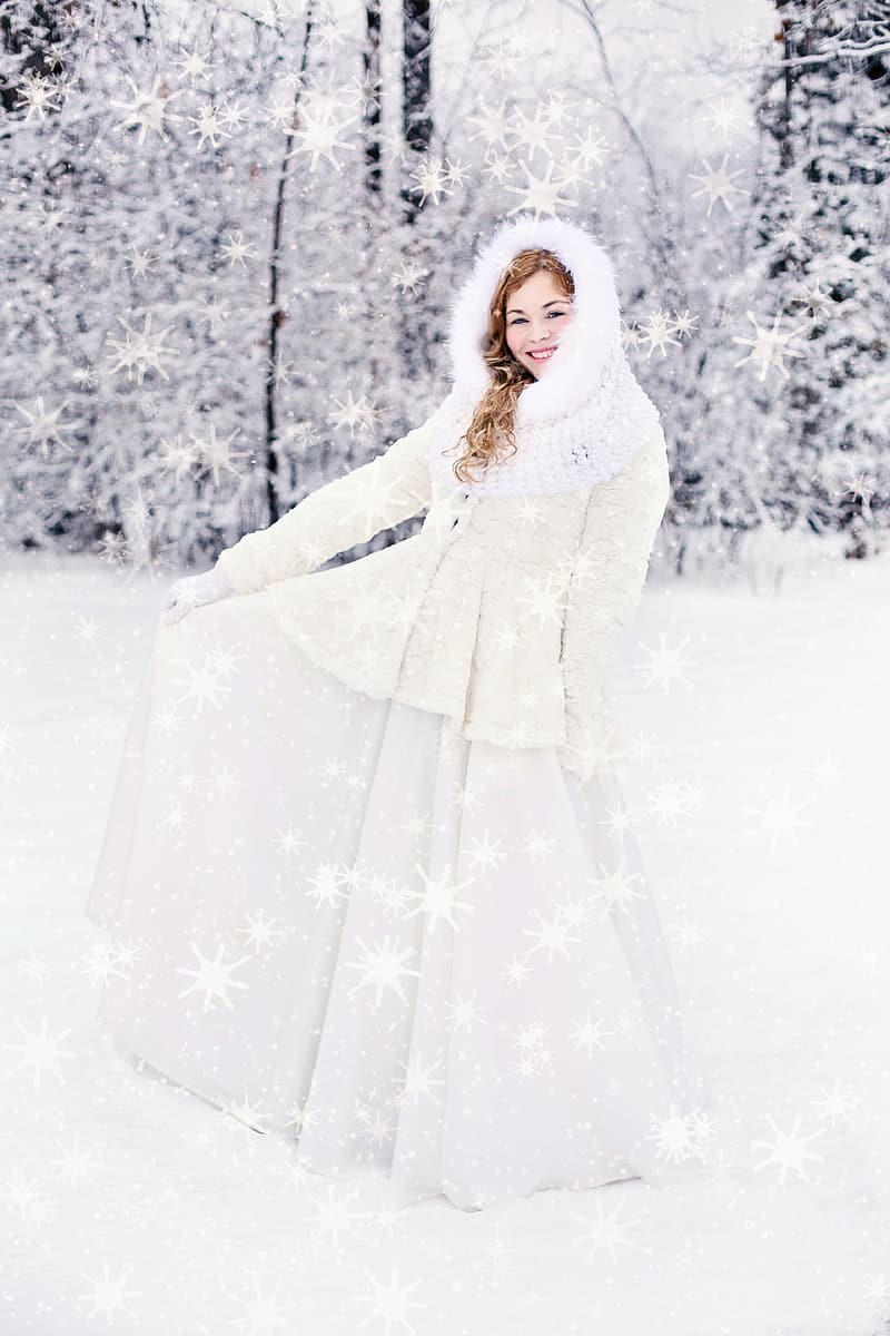 Woman wearing long-sleeved dress standing on snow