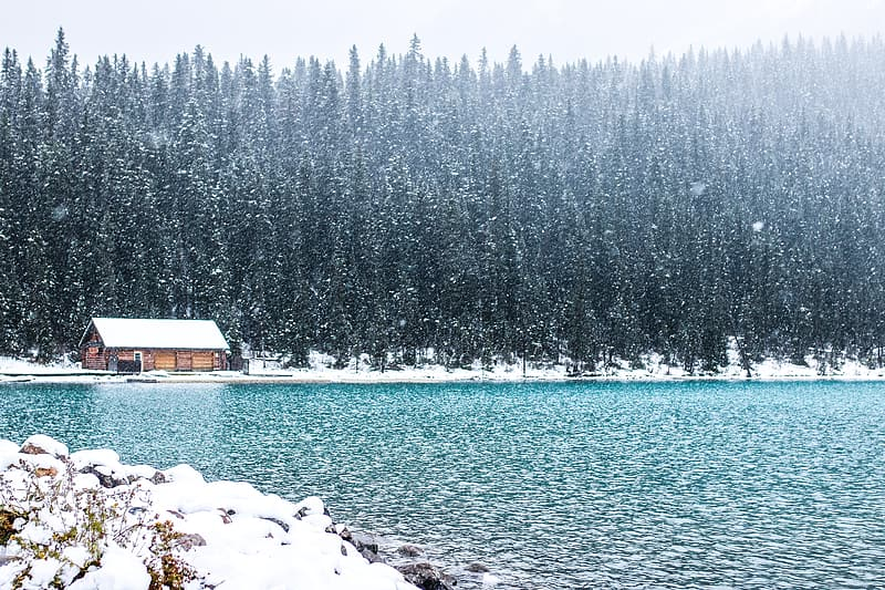 Bodies of water near house filled by snow photograph
