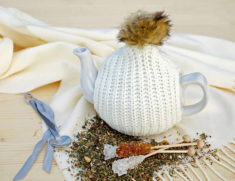 White ceramic teapot on textile