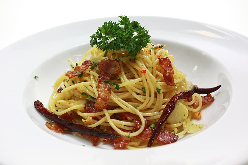 Pasta with bacon on plate