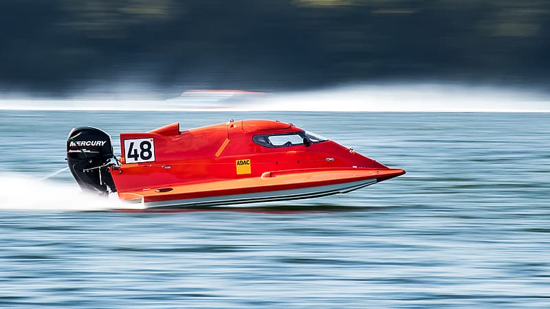 Time lapse photography of red powerboat