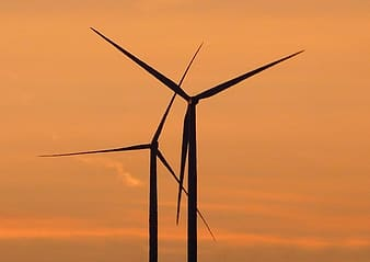 Silhouette of windmill during orange sunset