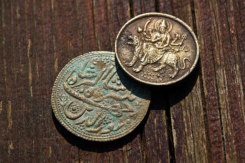 Two round bronze-colored Indian rupee coins
