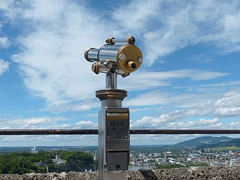 Silver and gold coin-operated telescope