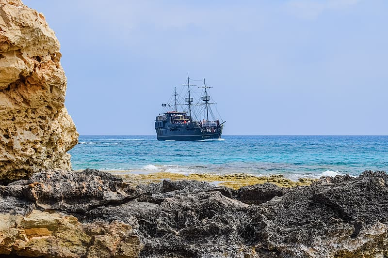 Black galleon ship on body of water at daytime
