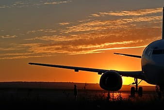 Silhouette of airplane during dusk