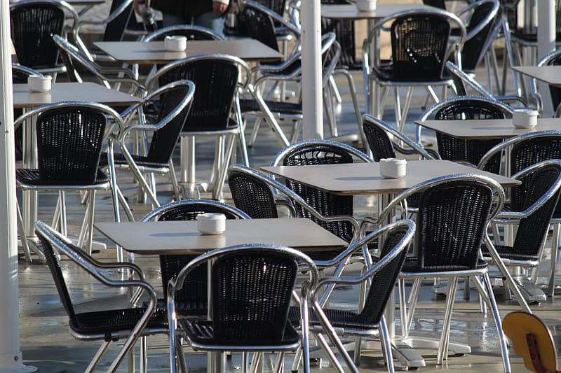 White-and-black patio table and chairs