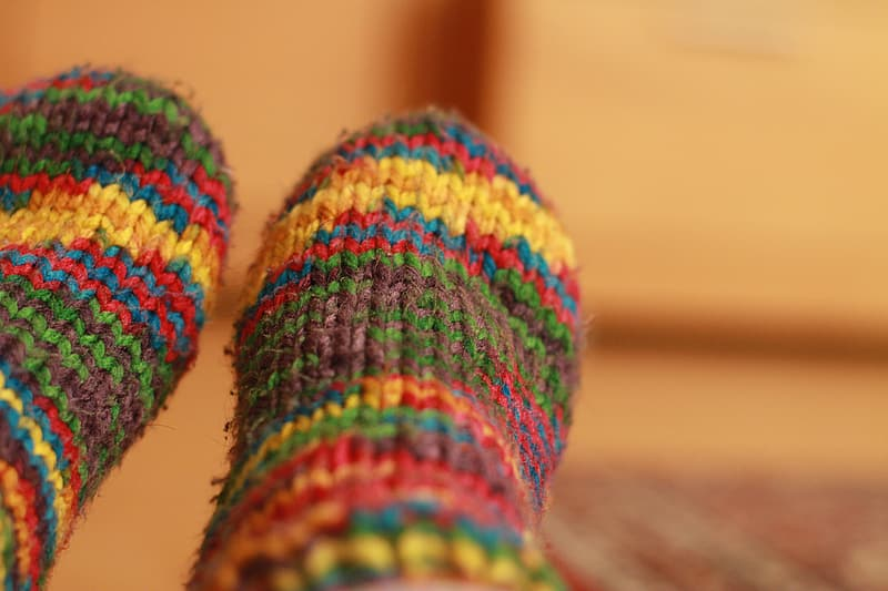 Selective focus photography of pair of multicolored foot socks