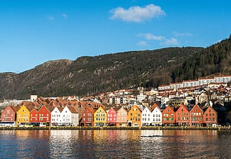 Assorted-color houses beside body of water