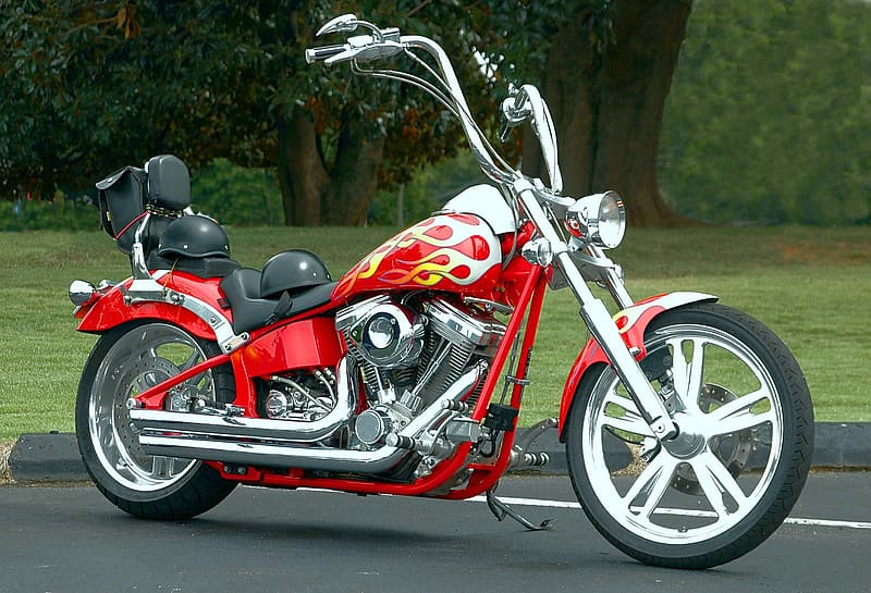 Red and black chopper motorcycle on road