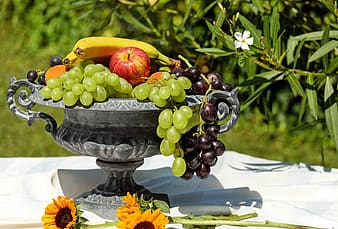 Assorted fruits on gray metal stemmed tray