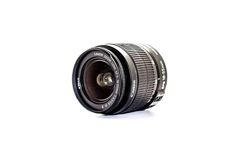 Black camera lens on white background
