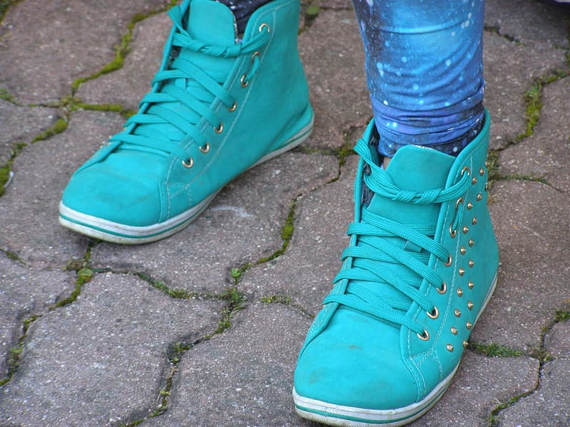 Person wearing green high top sneakers