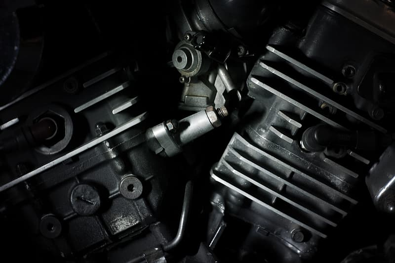 Black motorcycle twin engine in close-up photo