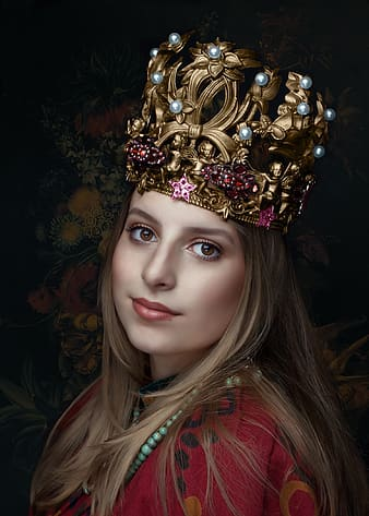 Woman in red shirt with gold crown