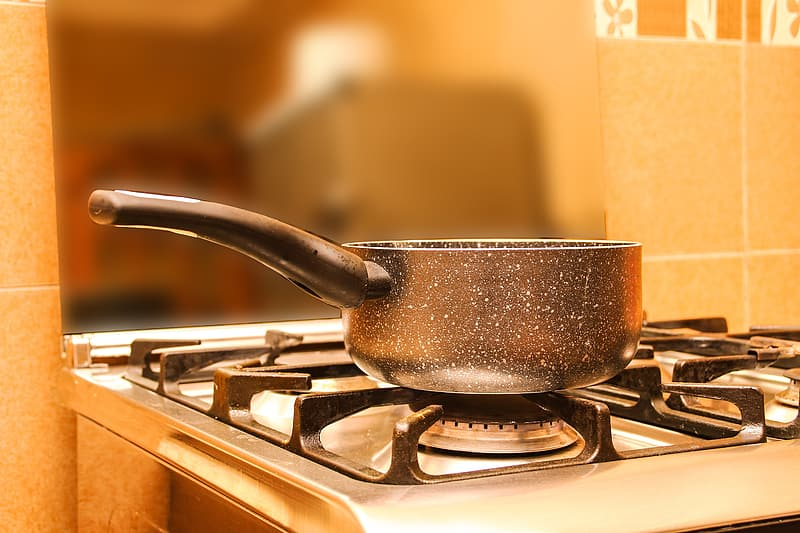 Black cooking pot on gas range oven