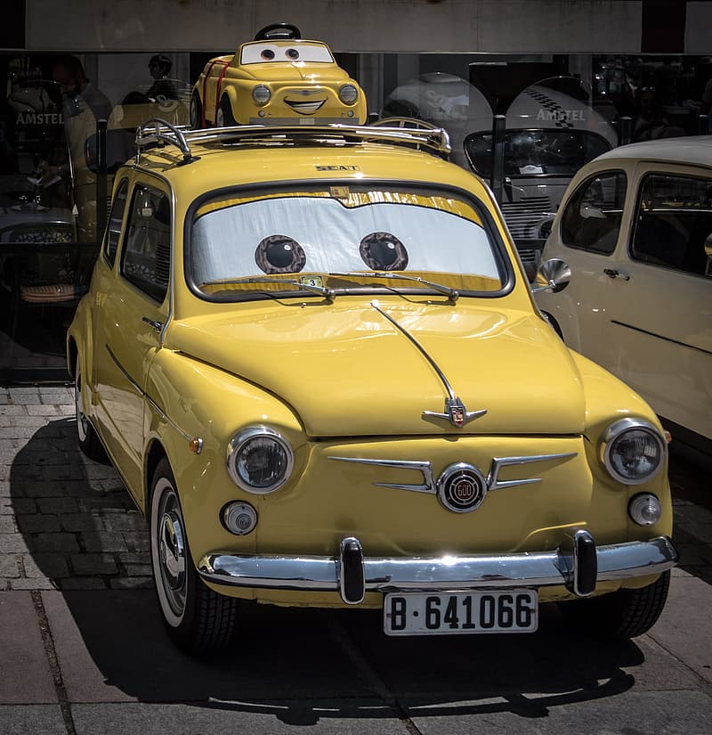 Yellow Disney Cars character themed vehicle