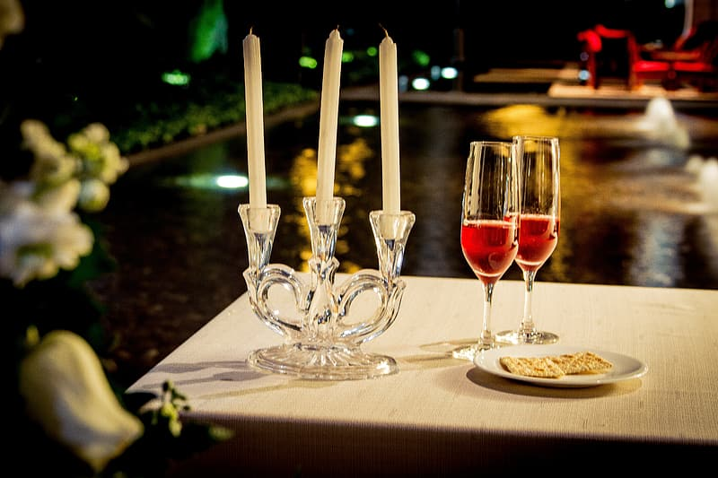 Tilt-shift photography of candles and flute glasses