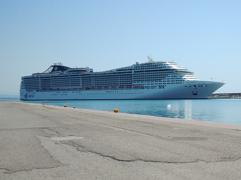 White cruise ship on blue body of water