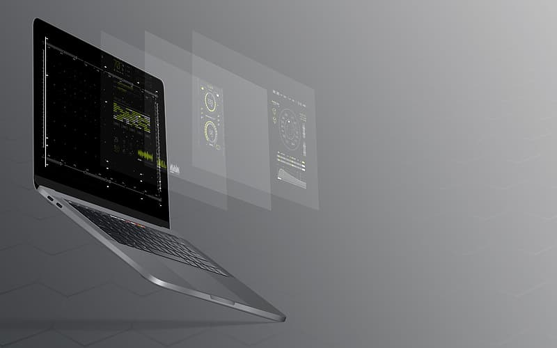 Black laptop computer turned on with grey background