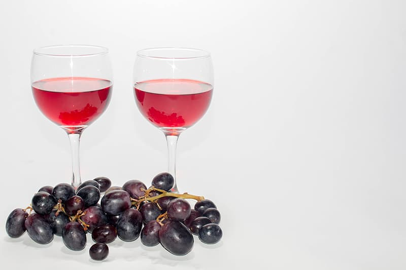 Grapes and grapes on clear wine glass