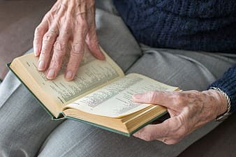 Person holding book on lap