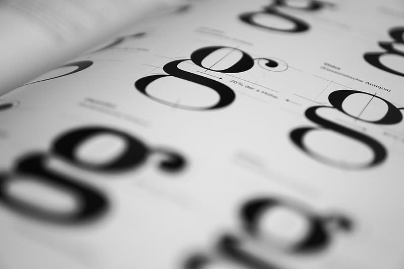 White and black g letter printed paper