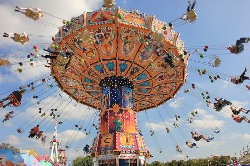 People in carnival ride during daytime