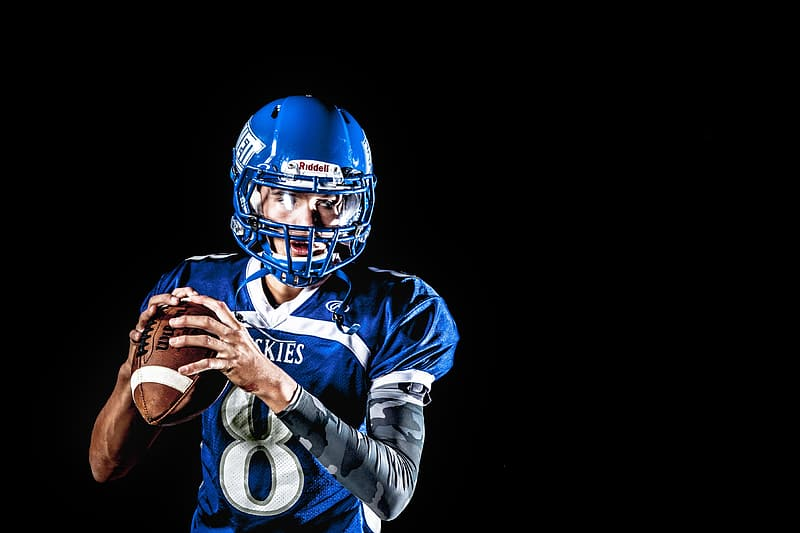 Football player with blue shirt and helmet
